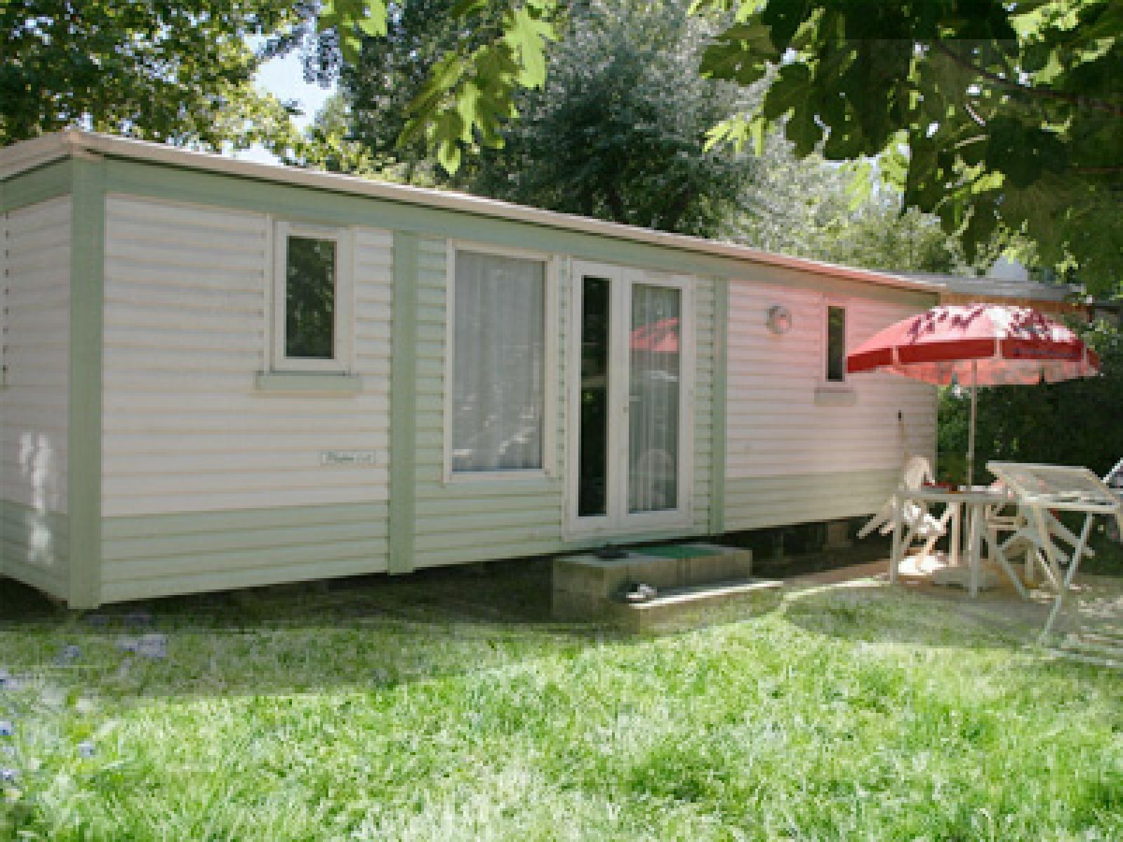 Services des mobil homes en location dans le camping abri - Mobil home dans son jardin ...